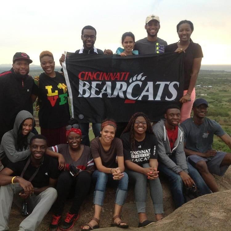"Photo of a brigade holding a ""Cincinnati Bearcats"" flag"