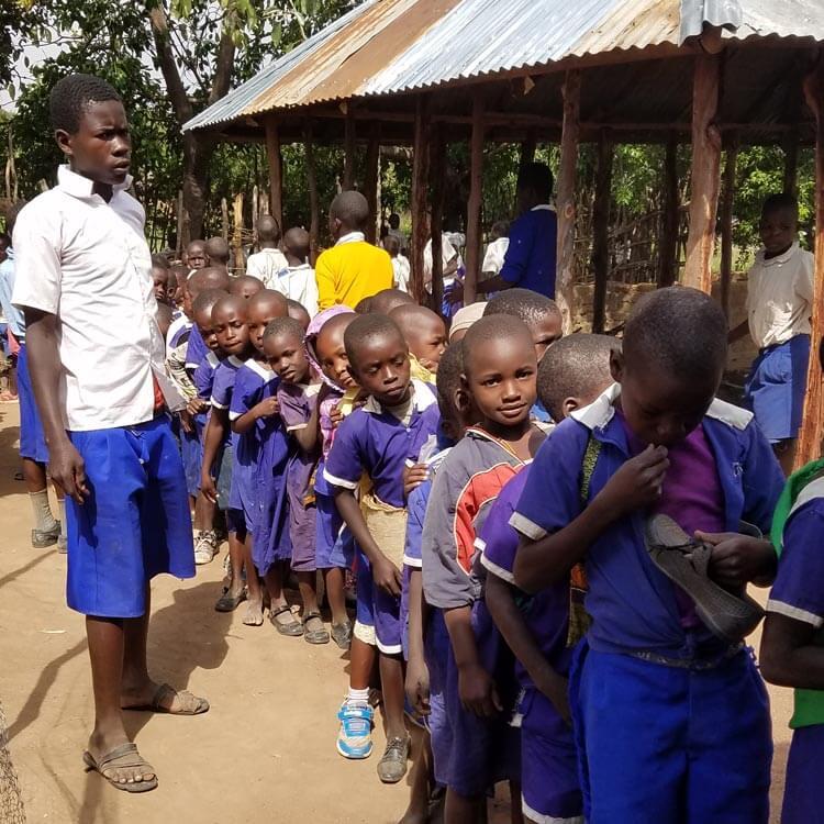 Photo of school children waiting in a queue