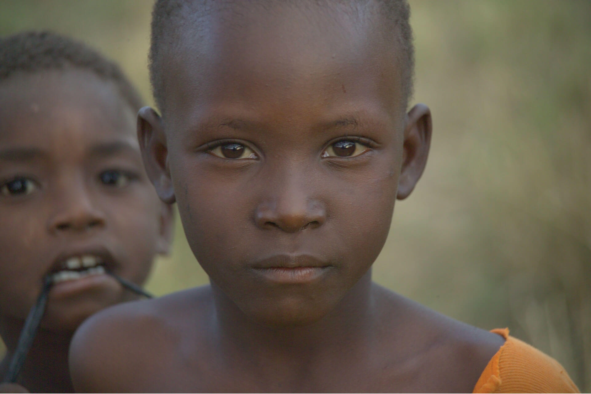 Photo of a child looking at the camera