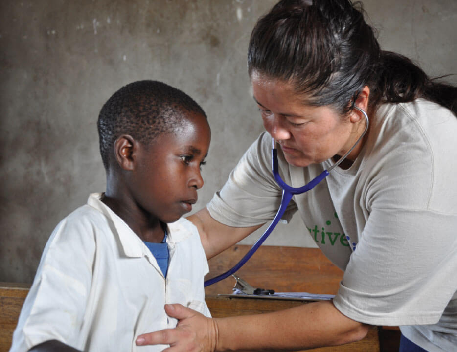 Photo of a child being examined by a doctor