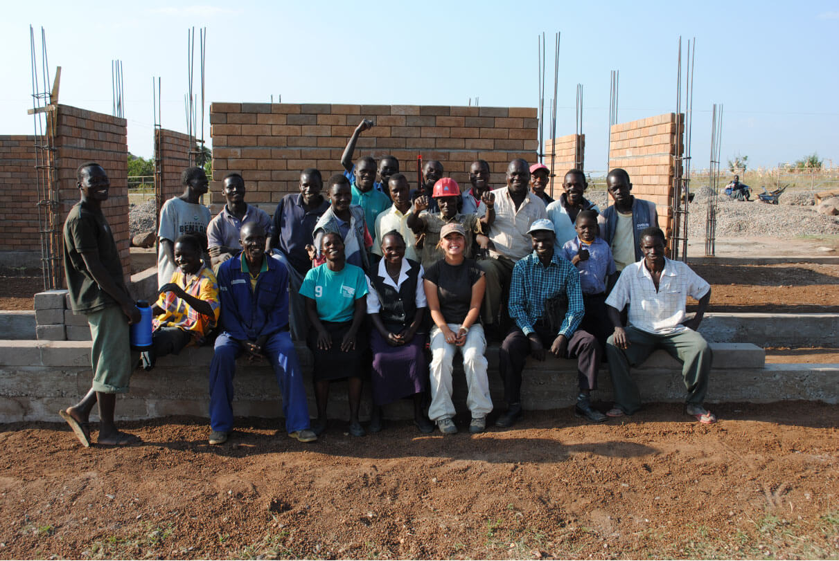 Photo of a group of people smiling at the Roche Health Center